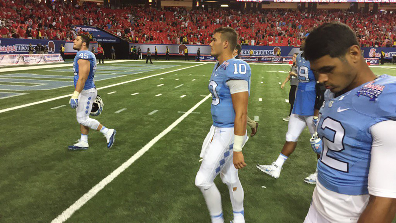 UNC players walk off the field in Atlanta after a loss to Georgia