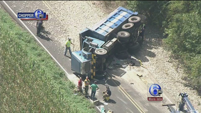 VIDEO: Dump truck rolls over, spills load on Route 113 in Bucks Co