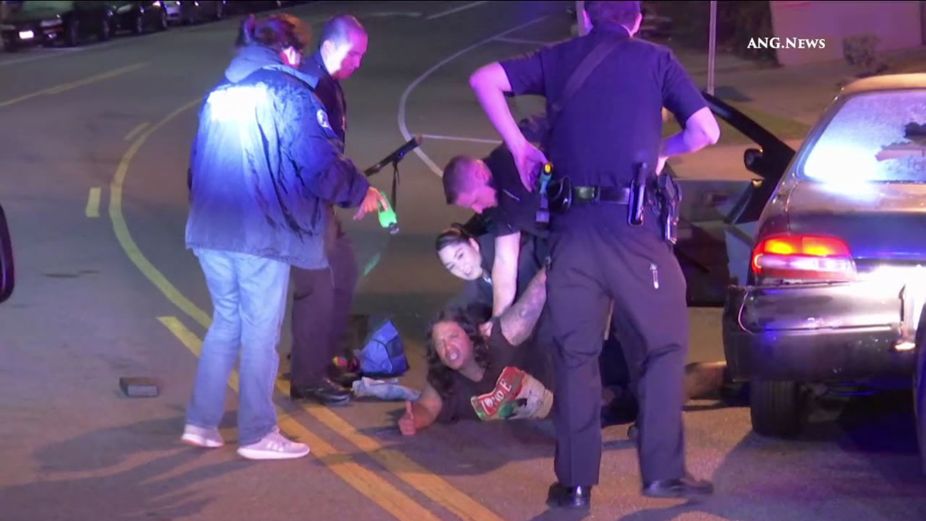 A driver was taken into custody after Los Angeles police officers shot out windows of his vehicle at the end of a pursuit on Wednesday, Sept. 7, 2016.