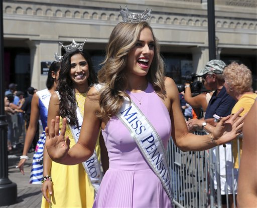 "<div class=""meta image-caption""><div class=""origin-logo origin-image none""><span>none</span></div><span class=""caption-text"">Miss Pennsylvania, Samantha Lambert waves as she is introduced during Miss America Pageant arrival ceremonies Tuesday, Aug. 30, 2016, in Atlantic City. (AP)</span></div>"