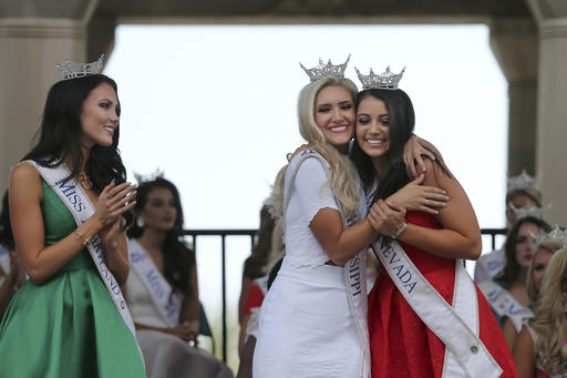 "<div class=""meta image-caption""><div class=""origin-logo origin-image none""><span>none</span></div><span class=""caption-text"">Miss Maryland, Hannah Brewer, left, looks on as Miss Mississippi, Laura Lee Lewis and Miss Nevada, Bailey Gumm hug during arrival cerem (AP)</span></div>"