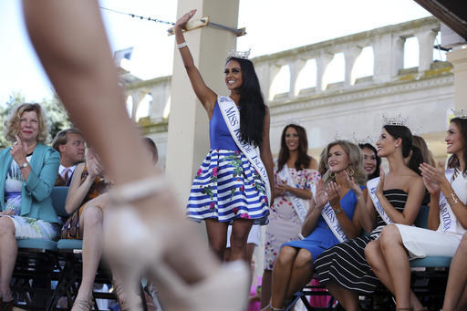 "<div class=""meta image-caption""><div class=""origin-logo origin-image none""><span>none</span></div><span class=""caption-text"">Miss Rhode Island, Shruti Nagarajan waves as she is introduced during Miss America Pageant arrival ceremonies Tuesday, Aug. 30, 2016, in Atlantic City. (AP)</span></div>"
