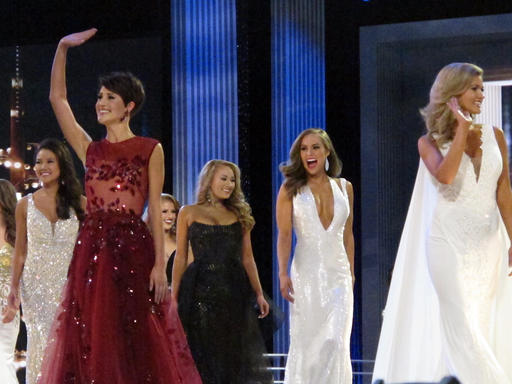 "<div class=""meta image-caption""><div class=""origin-logo origin-image none""><span>none</span></div><span class=""caption-text"">Contestants in the evening gown portion of the Miss America pageant compete on the first night of preliminary competition in Atlantic City (AP)</span></div>"