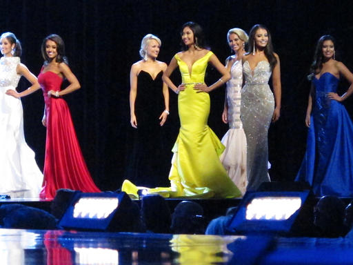 "<div class=""meta image-caption""><div class=""origin-logo origin-image none""><span>none</span></div><span class=""caption-text"">Contestants in the evening gown portion of the Miss America pageant compete on the first night of preliminary competition in Atlantic City, Tuesday, Sept. 6, 2016. (AP)</span></div>"