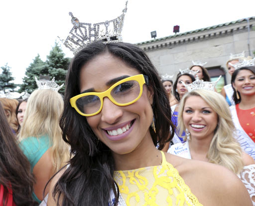 "<div class=""meta image-caption""><div class=""origin-logo origin-image none""><span>none</span></div><span class=""caption-text"">Miss Puerto Rico Carole Rigualis wears bright yellow sunglasses during Miss America Pageant arrival ceremonies Tuesday, Aug. 30, 2016, in Atlantic City. (AP)</span></div>"