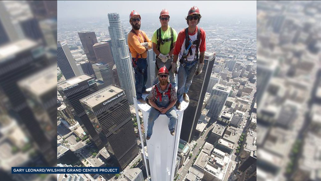 Four construction workers pose atop the Wilshire Grand Tower in downtown Los Angeles, the tallest building west of the Mississippi River at 1,099 feet.