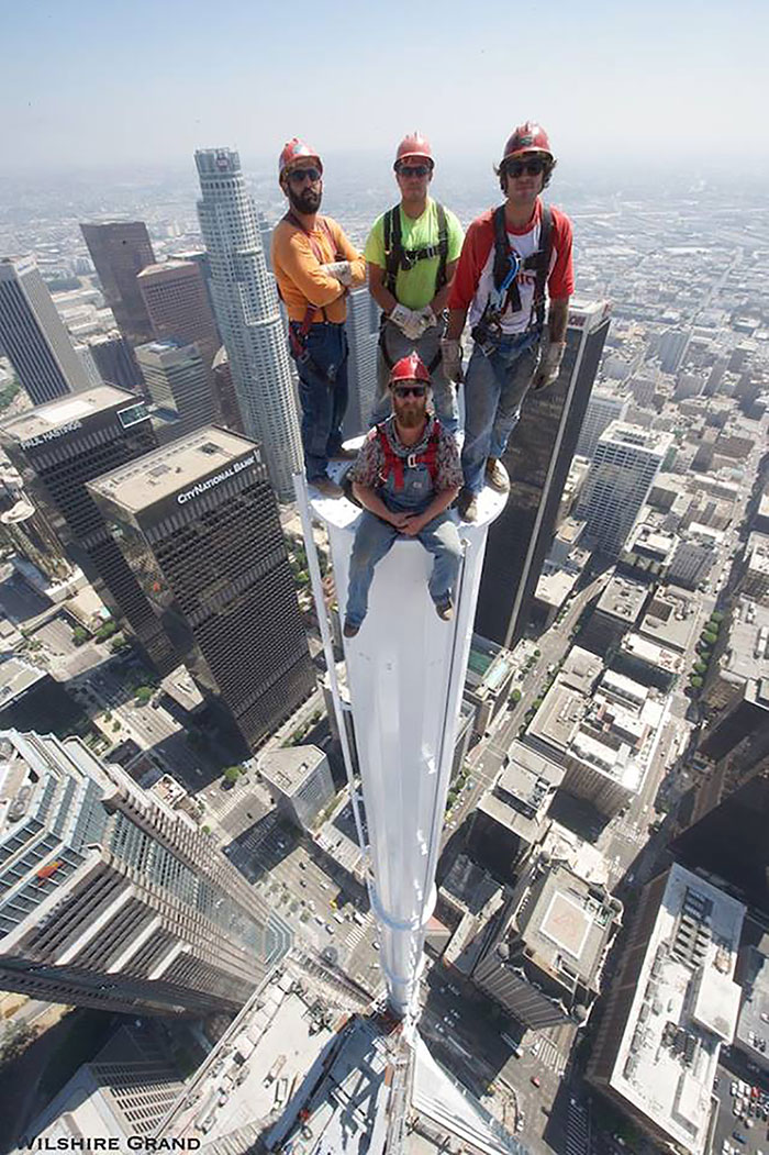 PHOTO: Workers pose for picture atop Wilshire Grand Tower in DTLA