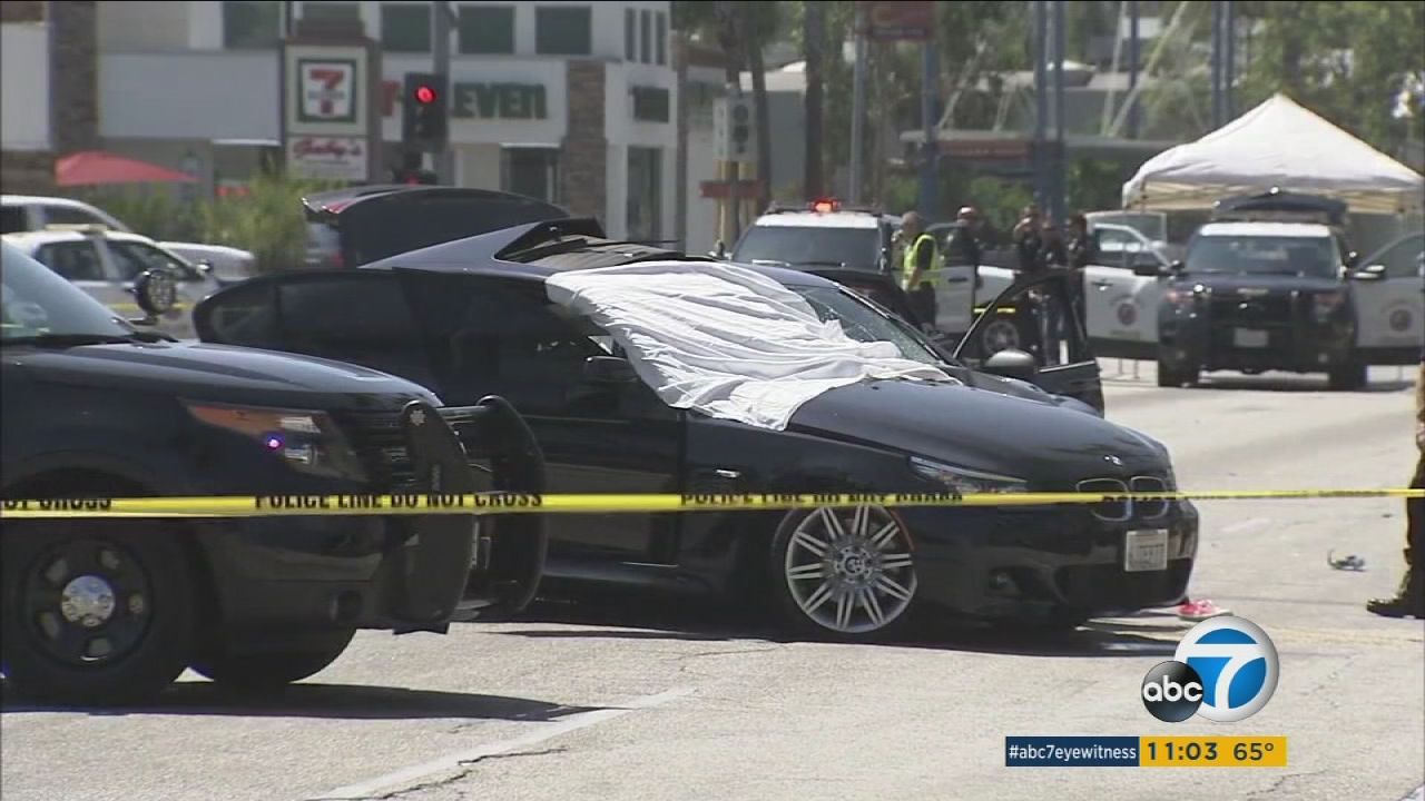 Police say a stolen car with a female underage driver behind the wheel ran a red light and plowed into a sedan, killing a father and injuring his 8-year-old son in Culver City.