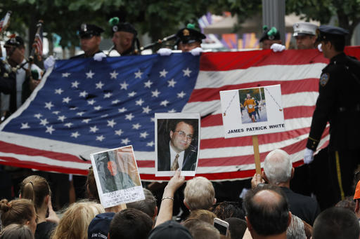 "<div class=""meta image-caption""><div class=""origin-logo origin-image ap""><span>AP</span></div><span class=""caption-text"">Mourners hold photos of their loved ones during the 15th anniversary of the attacks of the World Trade Center at the National September 11 Memorial, Sunday, Sept. 11, 2016. (AP Photo/Mary Altaffer)</span></div>"