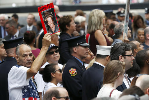 "<div class=""meta image-caption""><div class=""origin-logo origin-image ap""><span>AP</span></div><span class=""caption-text"">A mourner holds a photo of their loved one during the 15th anniversary of the attacks of the World Trade Center at the National September 11 Memorial, Sunday, Sept. 11, 2016. (AP Photo/Mary Altaffer)</span></div>"