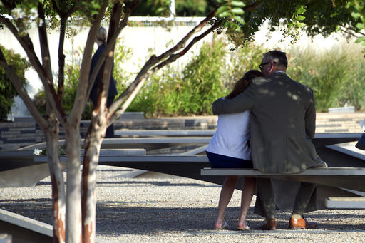 "<div class=""meta image-caption""><div class=""origin-logo origin-image ap""><span>AP</span></div><span class=""caption-text"">A couple hugs while sitting in the Pentagon Memorial prior to a Sept. 11 observance ceremony at the Pentagon, Sunday, Sept. 11, 2016. (AP Photo/Cliff Owen)</span></div>"