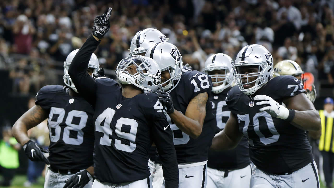 Oakland Raiders running back Jamize Olawale (49) reacts after scoring a touchdown in the second half of an NFL football game against the New Orleans Saints in New Orleans, Sunday, Sept. 11, 2016.