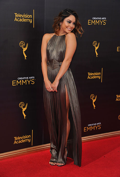 "<div class=""meta image-caption""><div class=""origin-logo origin-image none""><span>none</span></div><span class=""caption-text"">Vanessa Hudgens arrives at night two of the Television Academy's 2016 Creative Arts Emmy Awards at the Microsoft Theater. (Vince Bucci/Invision for the Television Academy/AP Images)</span></div>"