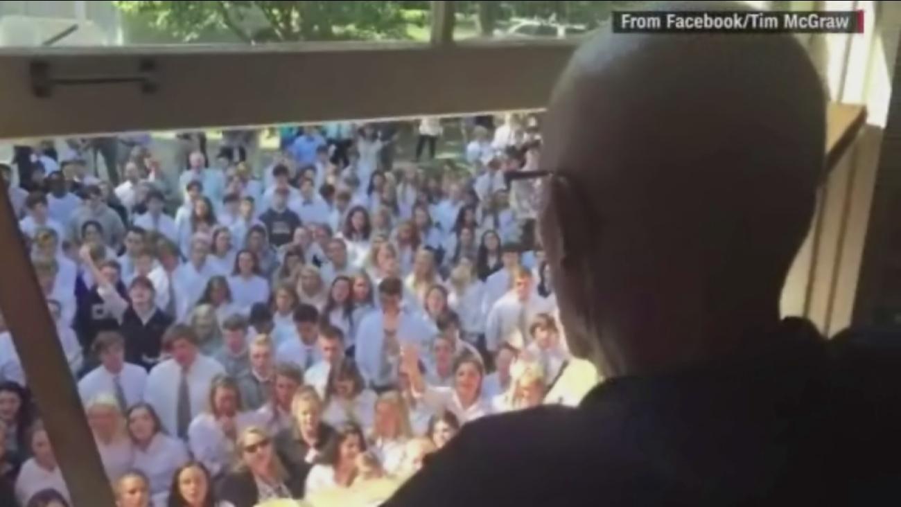 Hundreds of students and faculty members serenade Ben Ellis, a Tennessee high school teacher battling cancer,  on September 7, 2016.