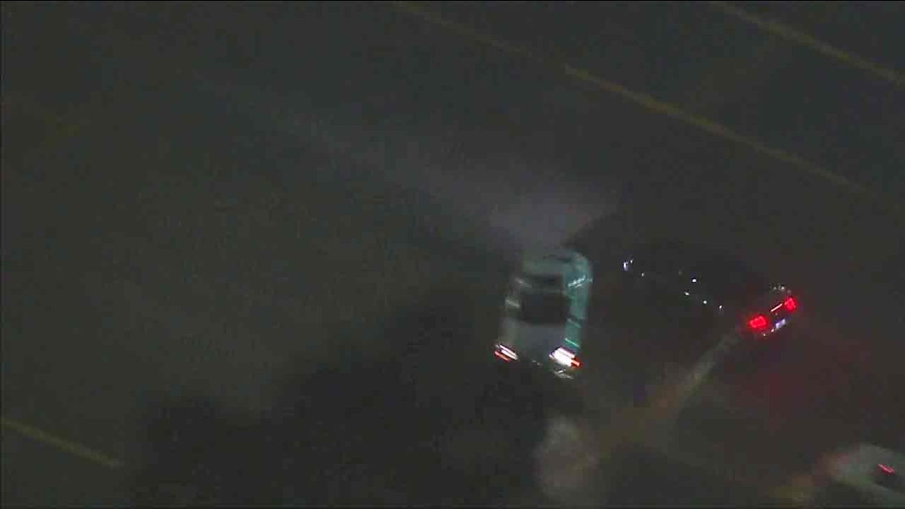 A Ford Mustang leading police on a chase near downtown Los Angeles on Monday, Sept. 12, 2016, is seen nearly clipping a car.