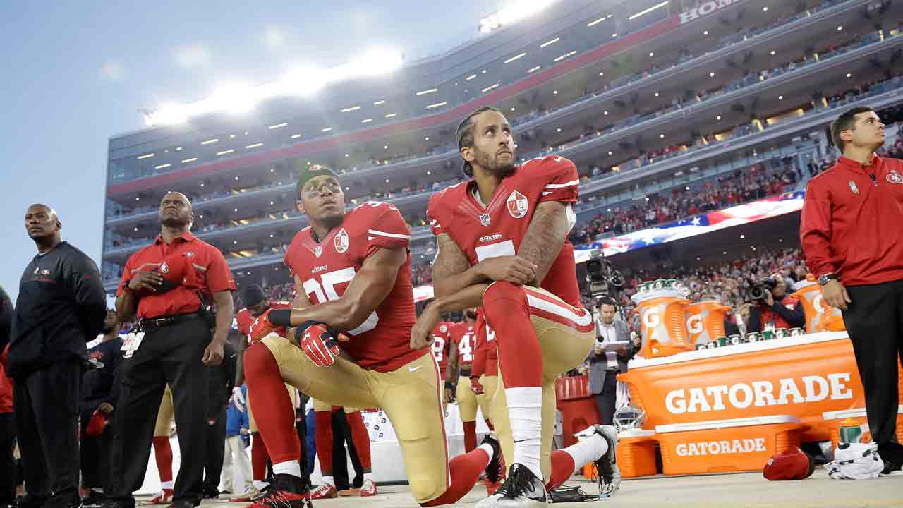 Eric Reid (35) and quarterback Colin Kaepernick (7) kneel during the national anthem before a game against the Los Angeles Rams in Santa Clara, Calif., Monday, Sept. 12, 2016.