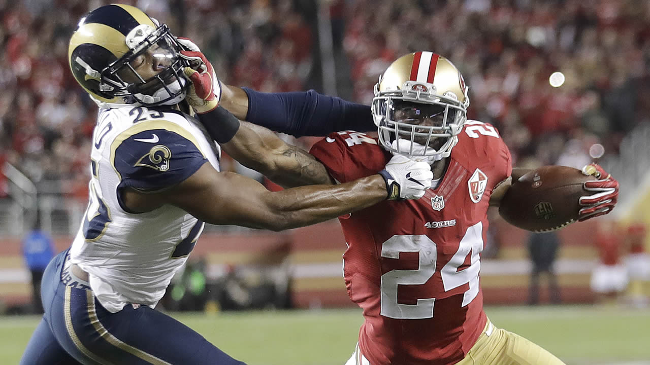 49ers running back Shaun Draughn (24) stiff arms Rams strong safety T.J. McDonald (25) during the season opener in Santa Clara, Calif., on  Monday, Sept. 12, 2016. (AP Photo)