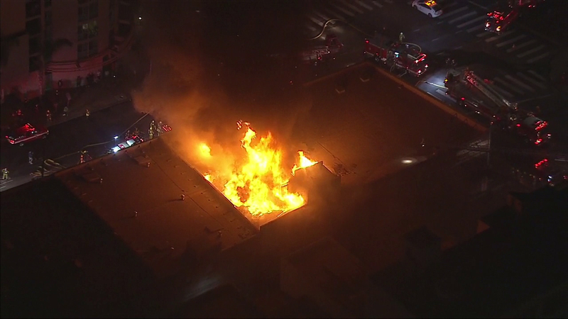 Firefighters extinguish dramatic blaze at smoke shop in downtown L A