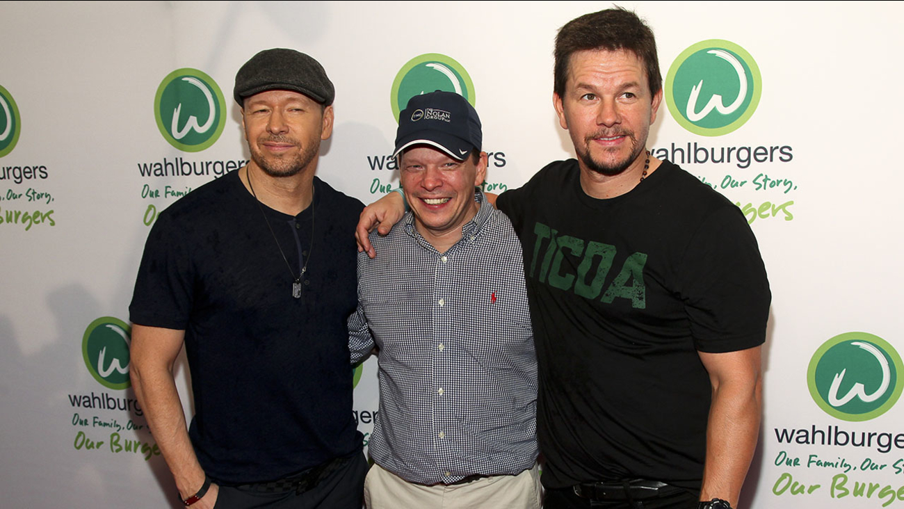 From left, Donnie Wahlberg, Paul Wahlberg and Mark Wahlberg attend the Wahlburgers Coney Island preview party on Tuesday, June 23, 2015.