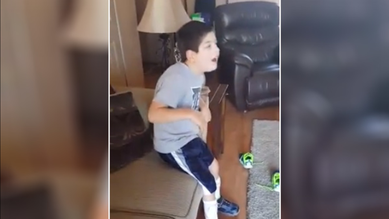 Boy with cerebral palsy stands for national anthem