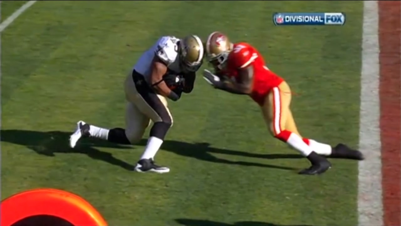 This undated image shows a player for the New Orleans Saints and a player for the San Francisco 49ers about to hit helmets.