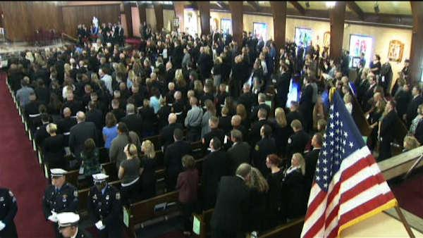 <div class='meta'><div class='origin-logo' data-origin='none'></div><span class='caption-text' data-credit=''>The funeral service and public viewing for Officer Bradley Fox in 2012.</span></div>