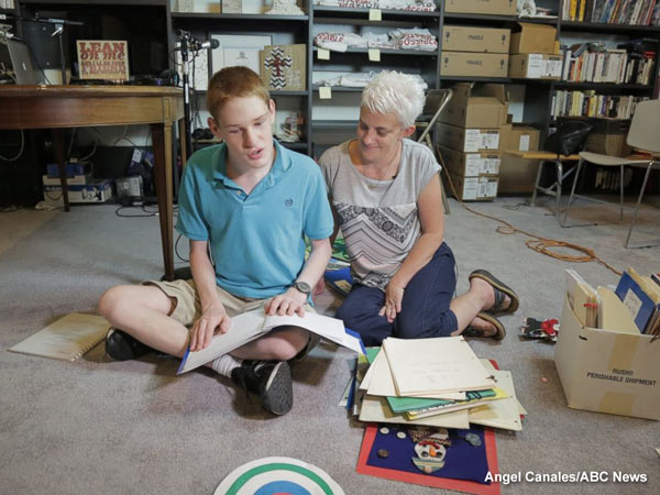 "<div class=""meta image-caption""><div class=""origin-logo origin-image none""><span>none</span></div><span class=""caption-text"">Christopher Duffley with his former Para Teacher Lisa Hanel in his home in Manchester, NH. July 26, 2016.</span></div>"
