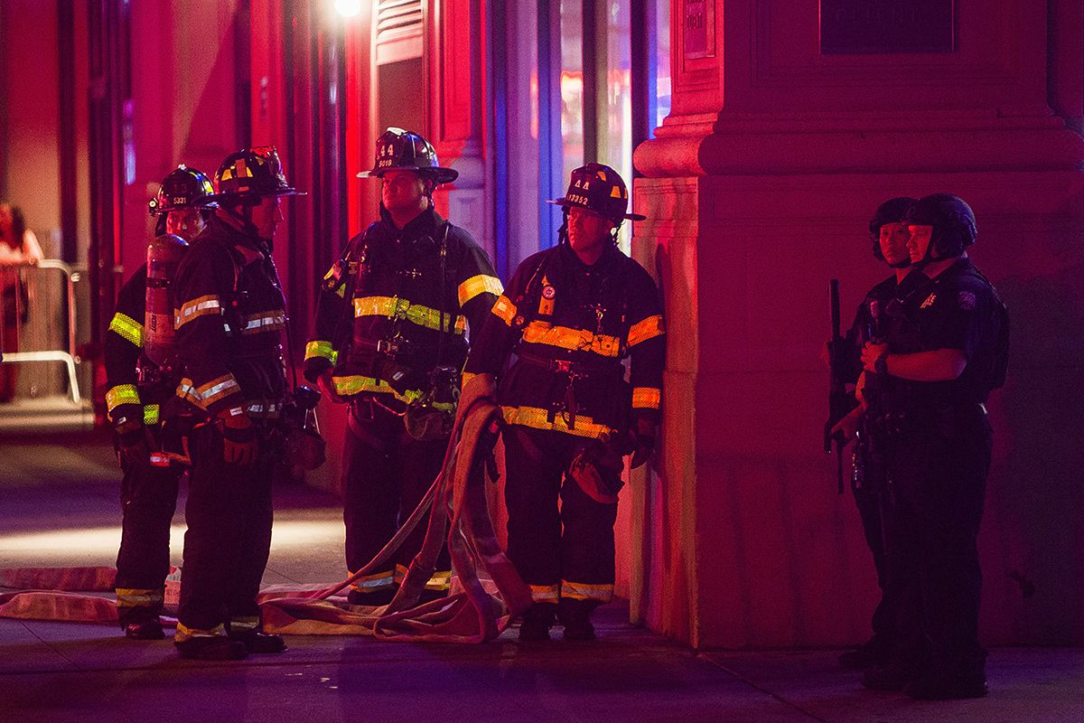 <div class='meta'><div class='origin-logo' data-origin='AP'></div><span class='caption-text' data-credit='AP Photo/Andres Kudacki'>Firefighters gather as heavily armed police block the area while they search for an explosive device on West 27th street and 7th Avenue in Manhattan, New York, Saturday, Sept. 17.</span></div>