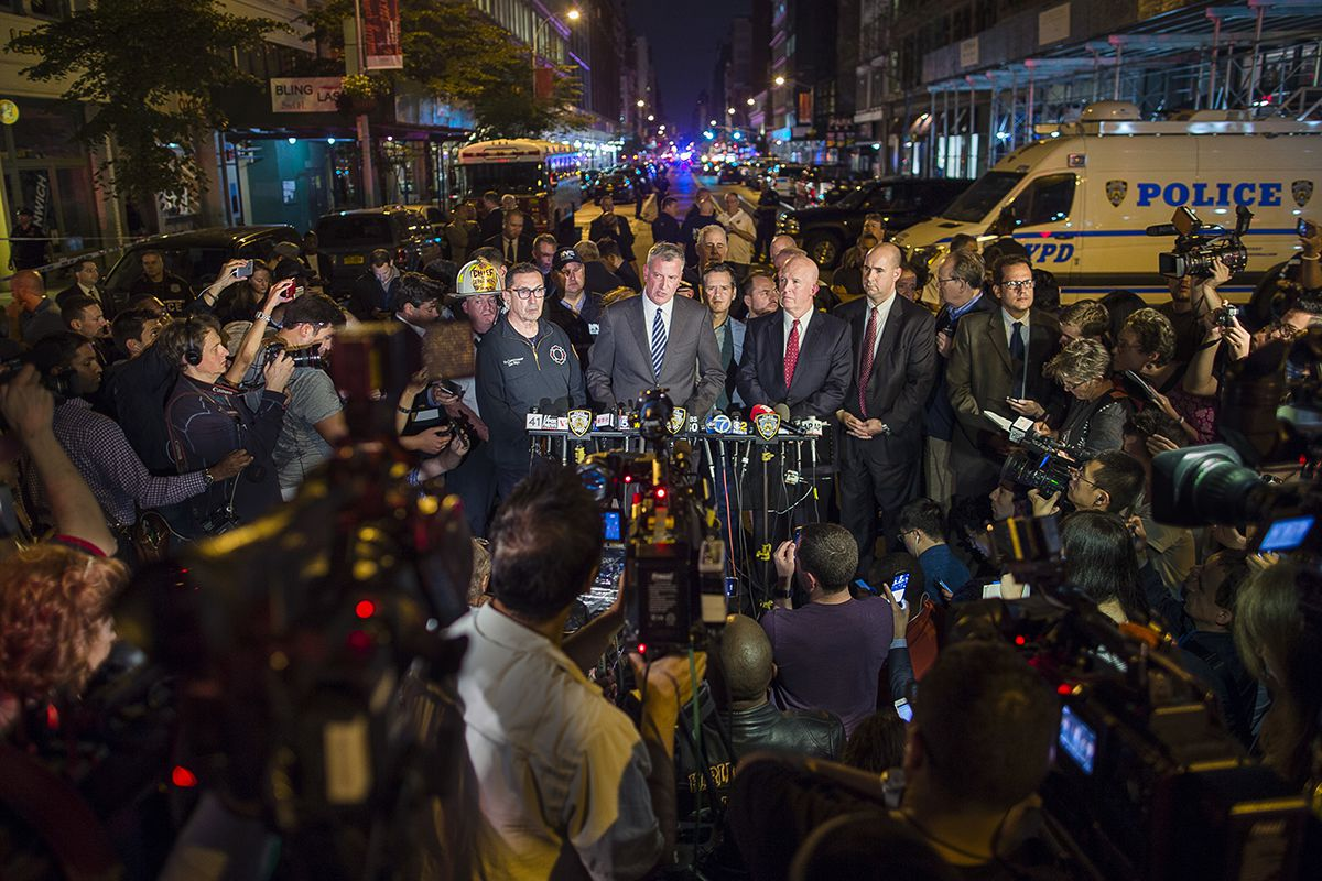 <div class='meta'><div class='origin-logo' data-origin='AP'></div><span class='caption-text' data-credit='AP Photo/Andres Kudacki'>Mayor Bill de Blasio, center, and NYPD Chief of Department James O'Neill, center right, speak during a press conference near the scene of an apparent explosion on West 23rd Street.</span></div>