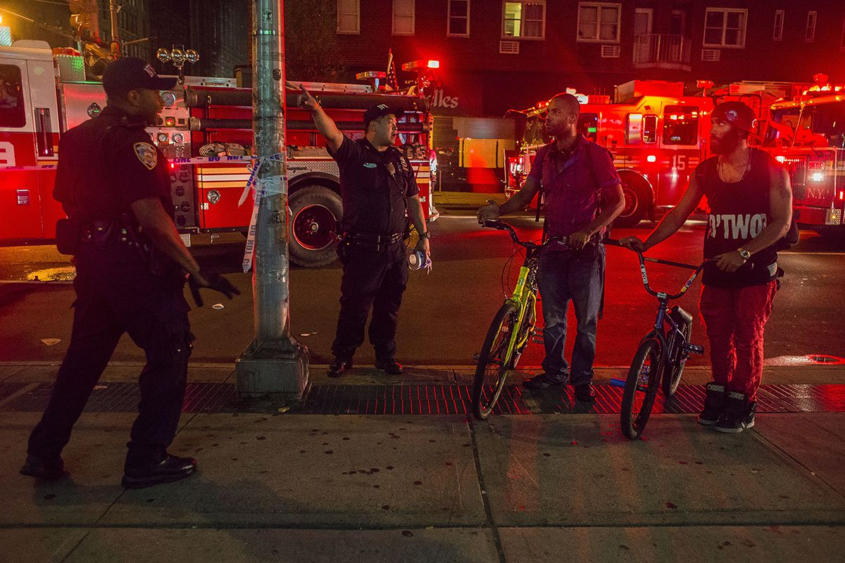 <div class='meta'><div class='origin-logo' data-origin='AP'></div><span class='caption-text' data-credit='AP Photo/Andres Kudacki'>Passersby are redirected by police officers as the police block the street near the scene of an explosion on West 23rd Street and 6th Avenue in Manhattan's Chelsea neighborhood.</span></div>