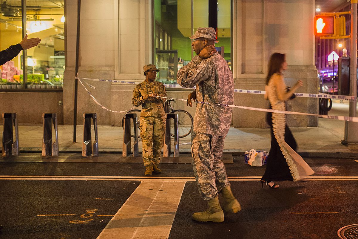 <div class='meta'><div class='origin-logo' data-origin='AP'></div><span class='caption-text' data-credit='AP Photo/Andres Kudacki'>People try to access the area near the scene of an explosion on West 23rd Street and 6th Avenue as members of the military stand guard in Manhattan's Chelsea neighborhood.</span></div>