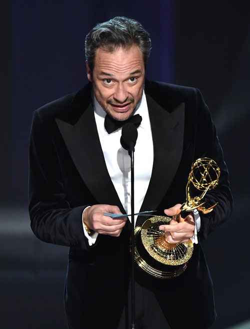 "<div class='meta'><div class='origin-logo' data-origin='AP'></div><span class='caption-text' data-credit='Photo by Vince Bucci/Invision for the Television Academy/AP Images'>D.V. DeVincentis accepts the award for outstanding writing for a limited series, movie or a dramatic special for ""The People v. O.J. Simpson: American Crime Story.&#34;</span></div>"