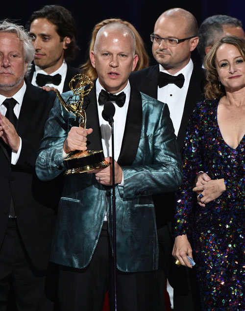 "<div class='meta'><div class='origin-logo' data-origin='AP'></div><span class='caption-text' data-credit='Photo by Vince Bucci/Invision for the Television Academy/AP Images'>Ryan Murphy and the cast and crew of ""The People v. O.J. Simpson: American Crime Story"" accept the award for outstanding limited series at the 68th Primetime Emmy Awards.</span></div>"