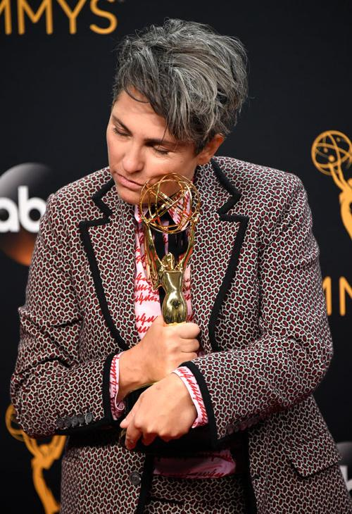 "<div class='meta'><div class='origin-logo' data-origin='AP'></div><span class='caption-text' data-credit='Photo by Phil McCarten/Invision for the Television Academy/AP Images'>Jill Soloway poses in the press room with the award for outstanding directing for a comedy series for ""Transparent"" at the 68th Primetime Emmy Awards on Sunday, Sept. 18, 2016.</span></div>"