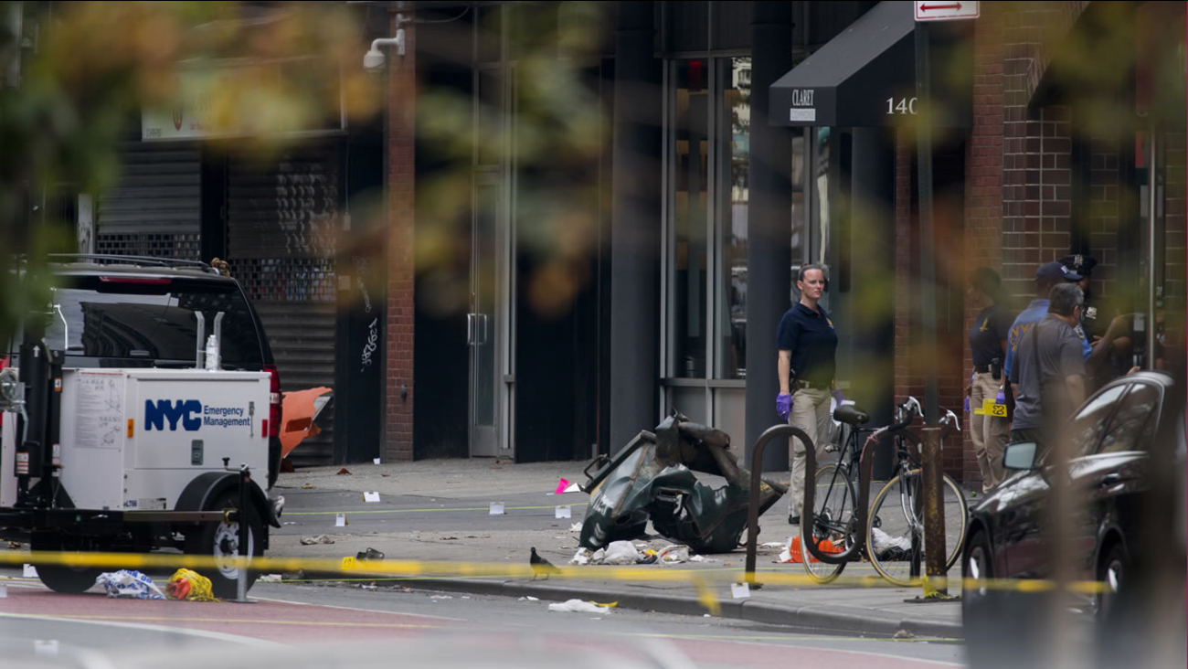Debris and a mangled toolbox sit on the sidewalk at the scene of an explosion on West 23rd street in the Chelsea neighborhood of New York, Sunday, Sept. 18, 2016. (AP Photo)