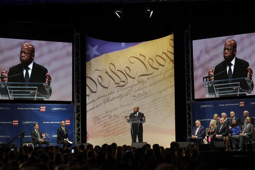 """<div class=""""meta image-caption""""><div class=""""origin-logo origin-image ap""""><span>AP</span></div><span class=""""caption-text"""">Rep. John Lewis, D-Ga., speaks after being presented with the Liberty Medal for his dedication to civil rights during a ceremony at the National Constitution Center. (AP Photo/Matt Slocum)</span></div>"""