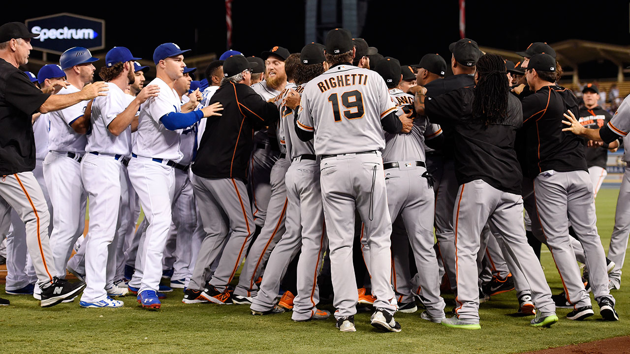 The Giants and Dodgers scuffle after Yasiel Puig was thrown out at first by San Francisco pitcher Madison Bumgarner.