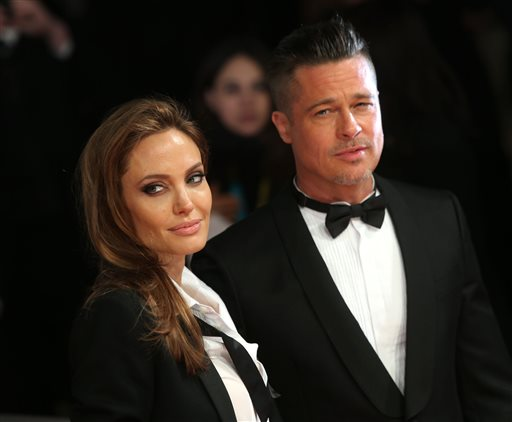 "<div class=""meta image-caption""><div class=""origin-logo origin-image none""><span>none</span></div><span class=""caption-text"">Angelina Jolie and Brad Pitt pose for photographers on the red carpet at the EE British Academy Film Awards Feb. 16, 2014, in London. (Photo by Joel Ryan/Invision/AP) (Joel Ryan/Invision/AP)</span></div>"