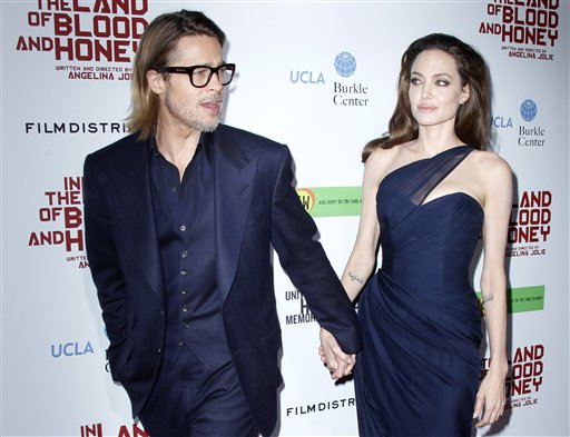 "<div class=""meta image-caption""><div class=""origin-logo origin-image none""><span>none</span></div><span class=""caption-text"">Brad Pitt and Angelina Jolie pose at the premiere in Los Angeles, Thursday, Dec. 8, 2011. (AP Photo/Danny Moloshok) (AP)</span></div>"