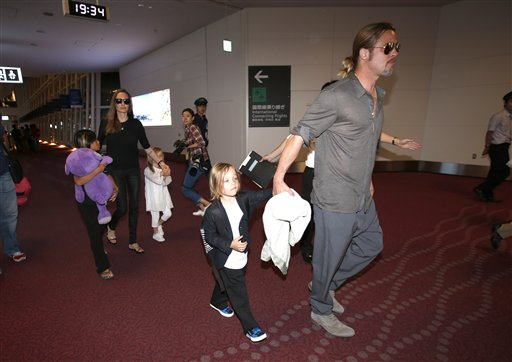 "<div class=""meta image-caption""><div class=""origin-logo origin-image none""><span>none</span></div><span class=""caption-text"">Brad Pitt and Angelina Jolie along with their children arrive at Haneda international airport in Tokyo, Sunday, July 28, 2013. (AP Photo/Shizuo Kambayashi) (AP)</span></div>"