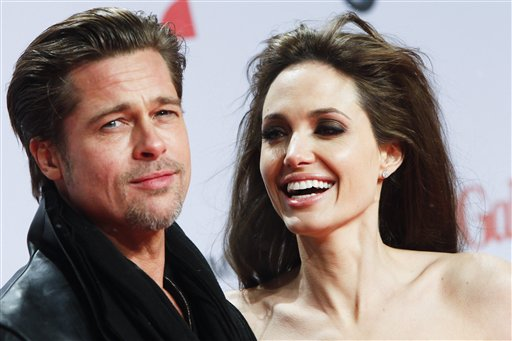 "<div class=""meta image-caption""><div class=""origin-logo origin-image none""><span>none</span></div><span class=""caption-text"">U.S. actors Angelina Jolie, right, and Brad Pitt arrive at the European premier of the movie ""The Tourist"" in Berlin on Tuesday, Dec. 14, 2010. (AP Photo/Markus Schreiber) (AP)</span></div>"