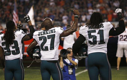 <div class='meta'><div class='origin-logo' data-origin='none'></div><span class='caption-text' data-credit='AP'>Philadelphia Eagles defensive back Ron Brooks (33),  safety Malcolm Jenkins (27) and defensive end Steven Means (51) raise their fists during the national anthem.</span></div>