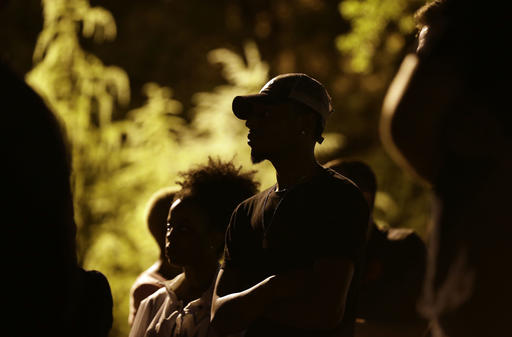 <div class='meta'><div class='origin-logo' data-origin='none'></div><span class='caption-text' data-credit=''>People gather for a vigil at the scene of the police shooting of Keith Lamont Scott in Charlotte. (AP Photo/Gerry Broome)</span></div>