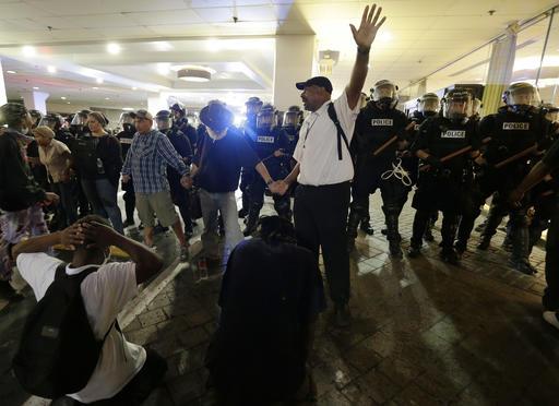 <div class='meta'><div class='origin-logo' data-origin='none'></div><span class='caption-text' data-credit=''>Demonstrators protest in Charlotte. (AP Photo/Chuck Burton)</span></div>