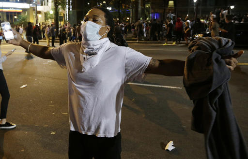 <div class='meta'><div class='origin-logo' data-origin='none'></div><span class='caption-text' data-credit=''>Demonstrators in Charlotte. (AP Photo/Chuck Burton)</span></div>