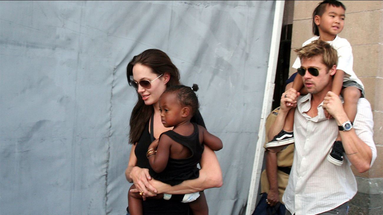 In this Nov. 12, 2006 file photo,  actress and UNHCR Ambassador Angelina Jolie, left, with her daughter Zahara, and Brad Pitt, right, with Jolie's son Maddox, walk in India.