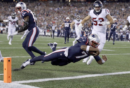 "<div class=""meta image-caption""><div class=""origin-logo origin-image ap""><span>AP</span></div><span class=""caption-text"">New England Patriots quarterback Jacoby Brissett (7) dives into the end zone for a touchdown past Houston Texans linebacker Max Bullough (53) during the first half. (Charles Krupa)</span></div>"