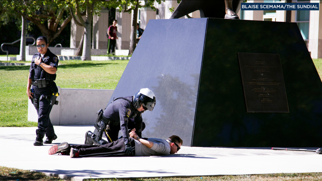 Cal State Northridge police officers arrest a man suspected of vandalizing property on campus with a sledgehammer on Friday, Sept. 23, 2016.