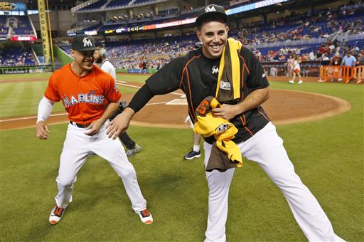 <div class='meta'><div class='origin-logo' data-origin='AP'></div><span class='caption-text' data-credit='AP'>Miami Marlins right fielder Giancarlo Stanton, left, and pitcher Jose Fernandez play around after having received their All-Star Game jerseys.</span></div>