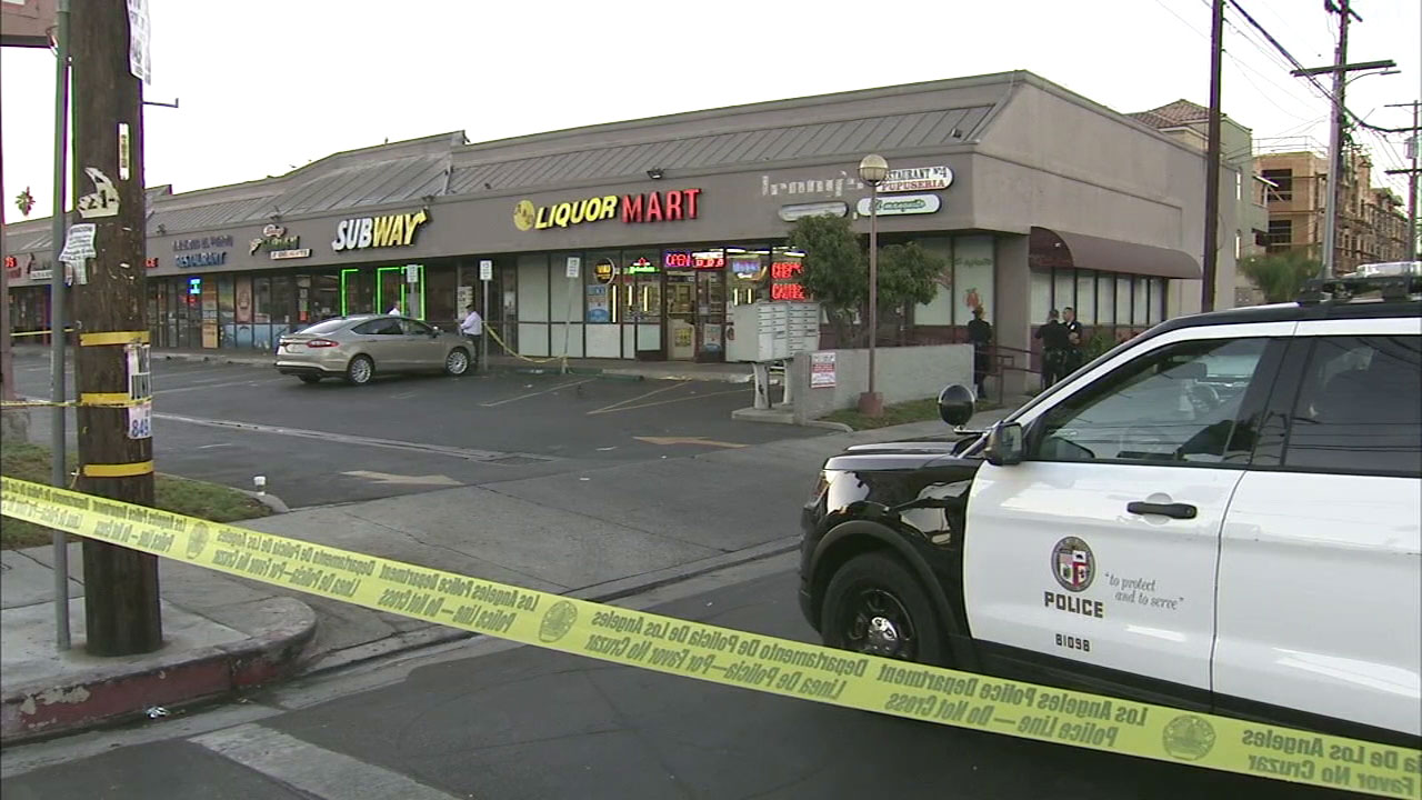 An investigation continued at a liquor store in North Hollywood on Sunday, Sept. 25, 2016, after a clerk was fatally shot late the previous evening.